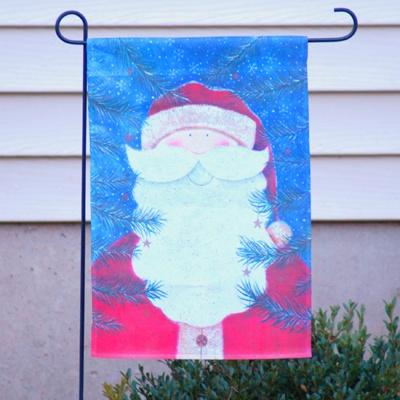 A garden flag with santa